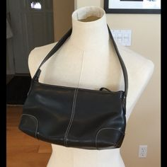 Black leather handbag with off-white stitching This is a great Nine West handbag in black leather with off white stitching accents. It is approximately 11 inches wide by 6 inches high and 3 inches wide across the bottom. The strap drop is approximately 9 inches. This bag is in great shape. No wear but there is a bit of a white mark along part of the top edge on one side. You can see it in the photo. Not very noticeable. Nine West Bags Shoulder Bags