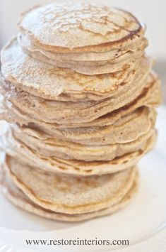 WHOLE WHEAT PANCAKES - 2 cups of 100% hard whole wheat,    2 teaspoons baking powder,    1 teaspoon salt,    2 eggs, well beaten,    1/2 to 2 cups milk,    2 tablespoons melted real butter,    1 tablespoon of Agave Nectar  or Organic Sucanat