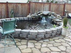 Very small outside water features and ponds for fish for Above ground koi pond ideas