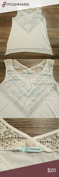 Adorable High Low Maurices Tank Large turquoise and tan Maurices tank. Only worn a few times. Higher in the front than in the back. Cute cut outs on the side. Let me know if you're interested! Maurices Tops Tank Tops