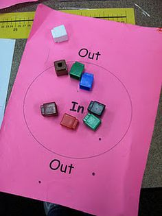 Laminate, shake out, count.  Reading opposites, using manipulatives (also  up, down - left, right)