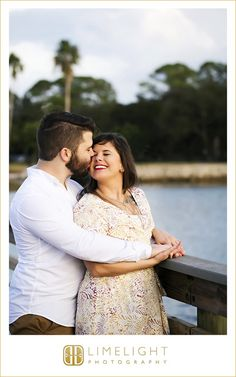 holding hands, outdoors, yellow, vintage, outdoor, international diamond center, engagement, engagement session, limelight photography, step into the limelight, boardwalk, pier, water, hugging, kissing, palm trees