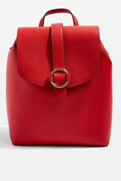 We're loving this ruby-red backpack. This slick style comes with a fold over top and striking metal ring hardware on the front. It's finished with adjustable straps, and a nifty top handle. It's great for adding a pop of colour to daytime looks.