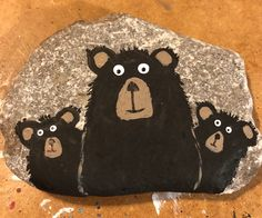 3 Black bears on a rock. Rock Painting Patterns, Rock Painting Ideas Easy, Rock Painting Designs, Pebble Painting, Pebble Art, Stone Painting, Painted Rock Animals, Painted Rocks Kids, Painted Stones