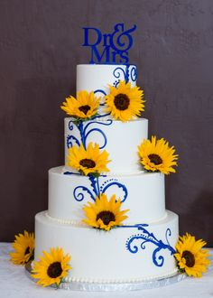 White and Blue Wedding Cake with Sunflowers and Custom Cake Topper