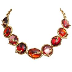 Pink, Orange and Fuhia-colored poured glass necklace gold plated metal. Yves Saint Laurent made by Robert Goossens, circa 1980.