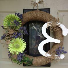 Burlap wreath with twine flowers.
