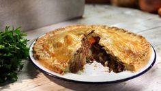 This double-crusted pie may have an old-fashioned thrifty feel, but it's ideal for a family supper, and very easy to put together. Use good-quality tinned corned beef for the best flavour and choose a reasonably waxy potato variety such as Desiree, that will hold its shape in the pie, giving a good texture.