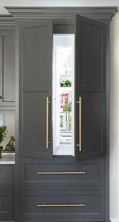 These days, people want everything in their kitchen to look beautiful — including their appliances. Thanks to this growing trend, you'll see more concealed coffee stations, microwave drawers and refrigerators disguised with cabinet fronts, like this one. Kitchen Ikea, Big Kitchen, White Kitchen Cabinets, Gray Cabinets, Kitchen White, Gold Kitchen, Order Kitchen, Kitchen Sink, Hidden Kitchen