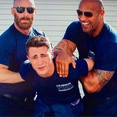 Some guy Colton Haynes (middle ) Dwayne the rock johnson (right)