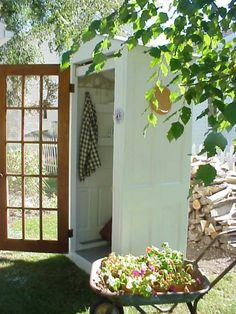 This DIY Little Shed Is A Great Way To Protect Your Garden Tools And Recycle Some Old Doors That Would Otherwise Become Landfill