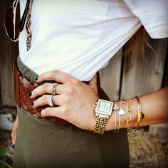 Gold watch and bracelets with white shirt and olive pencil skirt, and thick brown belt