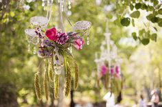Loving these chandeliers covered in flowers. Summer ski resort wedding at @plumpjackgroup Squaw Valley Inn with Tim Halberg Photography
