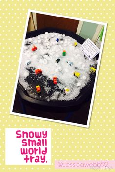 Snowy small world tray. The children loved using and making up story lines about different vehicles such as ambulances and diggers in the snow.