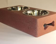 Beautiful handmade concrete dog bowl stand made from 98% recycled material primarily consisting of recycled glass and fly ash, a by product of burning coal. Tip roof, wind proof, spill proof and chew proof!
