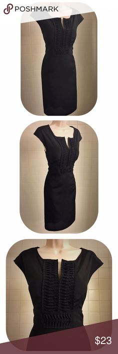"""Elegant Semi-Sheer Black Dress w/Cap Sleeves This elegant semi sheer black cap sleeved dress has a square neckline, which has a slit, opening up the detailed bodice of the dress. Below the bodice, the detailed waistline has an attached sash that ties in the back, cinching the waist & creating a flattering silhouette. Perfect for work or play, dress is easily dressed up or down. 38"""" long, fully lined. Measurements taken w/the dress lying flat: bust: 17.5"""",waist: 17.5"""", hips: 20"""". This dress…"""