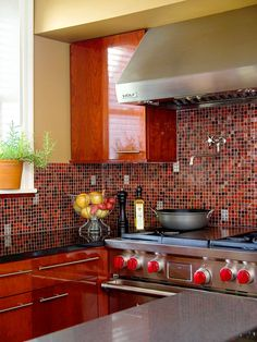 Variegated hues in this backsplash add just the right amount of contrast. More kitchen backsplash ideas: http://www.bhg.com/kitchen/backsplash/colorful-kitchen-backsplash-ideas/?socsrc=bhgpin070313orangered=8
