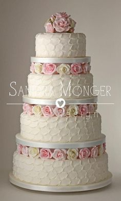 Would sculpt buttercream instead of making petals...love the roses!