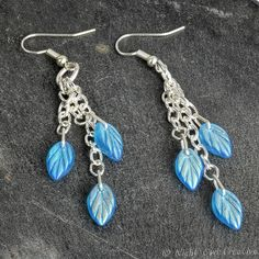 Dangle Earrings Turquoise Iridescent Czech Pressed Glass, Silver Plated Chain and Earwires, Aurora Borealis Finish, Leaf Charm by NightOwlCreative on Etsy
