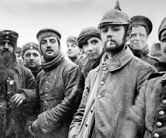 British and German troops mingle at Ploegsteert Wood in Flanders, during an unofficial Christmas truce in 1914