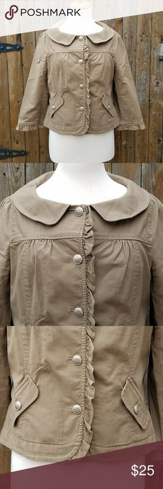 Ann Taylor LOFT Dark Tan Ruffle Blazer Jacket *There is an extra button in the right pocket.*  Size Medium Dark Tan Color Ruffle down front & edge of sleeves Sleeves are shorter than a typical long sleeve 98% Cotton & 2% Spandex  Measurements Bust is 38 inches Sleeve Length is 19 inches including the ruffle Length of blazer is 21 inches  Blazer is in excellent pre-owned condition! LOFT Jackets & Coats Blazers