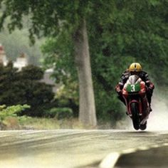 Buy Joey Dunlop in the Rain TT 1998 - This iconic photograph by Stephen Davison shows the legendary Joey Dunlop skating his Honda over the wet Manx. Robert Dunlop, Kawasaki Motorcycles, Manx, Moto Guzzi, Isle Of Man, Super Bikes, Road Racing, Motorbikes, Touring