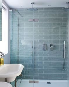 Looking for shower ideas? Check out this double shower with pale blue tiles for inspiration