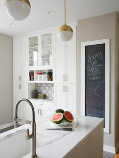 Chalkboard on pantry door. Amazing kitchen features white shaker cabinets paired with gray and white marble countertops and a gray subway tile backsplash. New Kitchen Cabinets, Shaker Kitchen, Kitchen Tops, Diy Kitchen, Kitchen Decor, Kitchen Design, Shaker Cabinets, Kitchen Rustic, Gray Subway Tile Backsplash