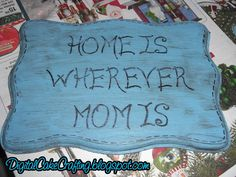 """""""Home is Wherever Mom is""""  Wall Plaque - can buy the plaque for around $2 at the local craft store (maybe the dollar store carries these?)"""