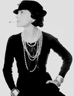 Coco Chanel helped to popularize Bakelite when she made 'costume' jewelry acceptable and affordable by using Bakelite. Collectors now pay thousands for the style of Bakelite cuff bracelets you see on her arm in the picture.