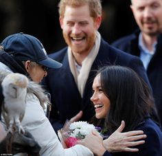 Miss Markle looked delighted to receive the flowers and words from the well-wisher at the ...