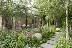 The Hartley Botanic Garden at Chelsea Flower Show featuring Atelier Vierkant pebbles