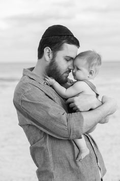 Father hugging daughter beach photo session