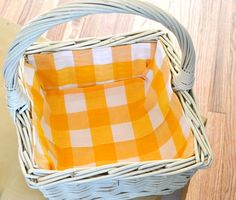 DIY Fabric lined baskets.  A cute way to spruce up an old basket