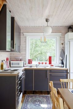 Love the big window over the sink!  |  blue + wood small space kitchen