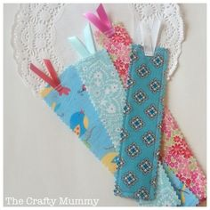 Tutorial: See how I combined a bunch of fabric strips and leftover interfacing to create Fabric Scrap Bookmarks.