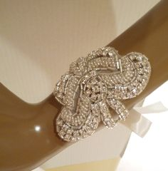 Bridal Rhinestone Bracelet in a Fleur De Lis Design made with your choice of satin color only $29.50 at www.BellaCescaBoutique.Etsy.com