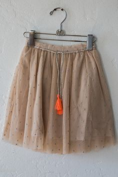 This is a girls' skirt, but I don't see any reason I couldn't make a full skirt with a gauzy top layer and tassels. Mine would probably be tea length.