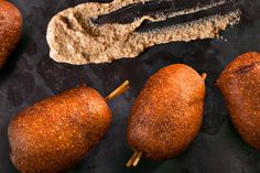 Mini Beer-and-Sausage Corn Dogs - Eastern Europe meets America in this sausage-y take on the corn dog using bratwurst or kielbasa sausages covered in a beer-cornmeal batter.