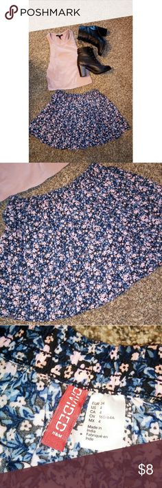 Floral Skater Skirt Pink, blue and black floral pattern skater skirt. Never worn. This skirt is so cute, but it is just to short on me because my legs are so long. It's in perfect condition! Divided Skirts Circle & Skater