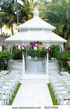 Beautiful White Wedding Gazebo With Flower Arrangements Decorating