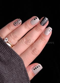 Mismatched nude, pink and black manicure with subtle heart and leopard print accents.