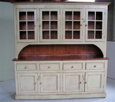 Distressed cream with stained wood. I plan on doing this with a small dresser we have repurposed for the entrance.