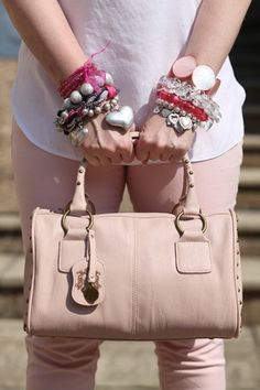 Arm candy - pink and silver stacking bracelets.