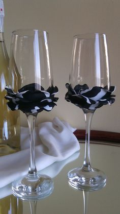 Set of 2 hand decorated Wedding Glasses champagne flutes Black and white Rose on Etsy, £23.89