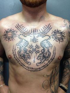 Grey Ink Traditional Thai Tattoo On Man Chest