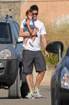 "Aww Fernando Torres and Nora  -- One of my favourite ""father and daughter"" pictures. And it's not because it features Fernando Torres and super cutie Nora, but it's because the father here was borrowing his daughter's pacifier. He's famous but he didn't care. He's a father and that's all that matters."