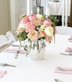 Bridal Shower Centerpieces: Antique silver teapot centerpiece arrangements: Roses, White Gloria Astilbe, Hanging Amaranths, Garden Roses, Hydrangea, Hypericum Coral Berries, Jasmine White Roses, Eucalyptus