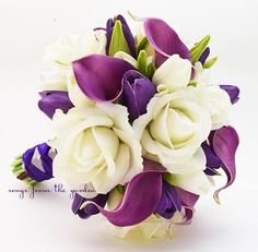 White Real touch roses with Real Touch purple calla lilies and Real Touch purple mini tulips create a lovely flower bridal bouquet that can be yours to have & to hold on your wedding day! I can create