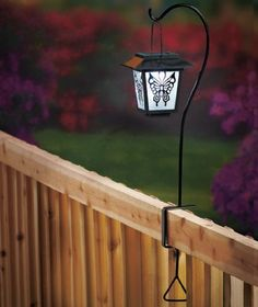 """Deck-Mount Solar Powered Lantern - Butterfly . $29.95. No screws necessary!. Made of Metal, glass and plastic. Measures 26-3/4"""" x 8"""" x 6"""", overall. Solar powered. This Deck-Mount Solar Lantern offers useful light and a decorative touch to your outdoor space. It has an adjustable bracket with a clamp that lets you easily mount it on a deck or rail without any screws. The lantern has a solar panel that soaks up the sun's energy during the day and a built-in sensor tha..."""